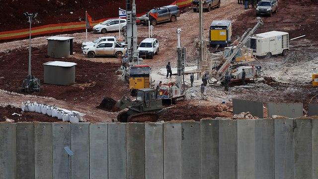 Israeli military equipment works on the Lebanese-Israeli border next to a wall Israel built  (Photo: AP)