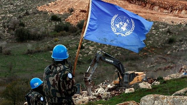 UN peacekeepers observe Israeli excavators working near the southern village of Mays al-Jabal    (Photo: AP)