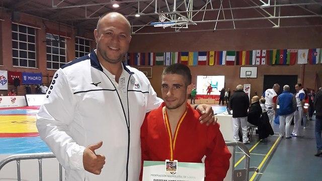 Таль Бородин и его тренер Павел Мусин. Фото: Яхав Коэн