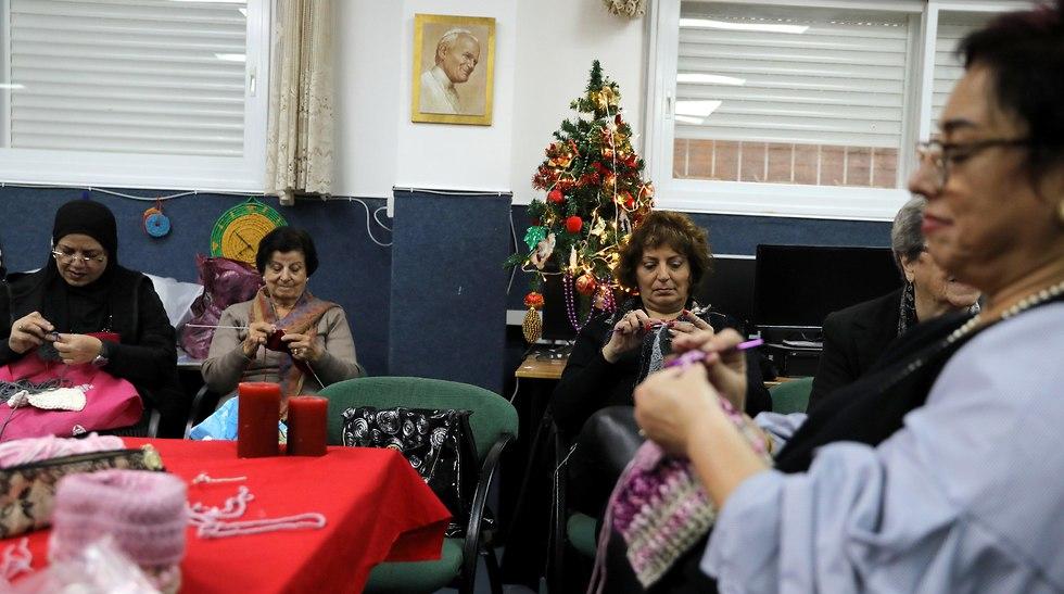 Women doing crafts in Nazareth (Photo: Reuters)
