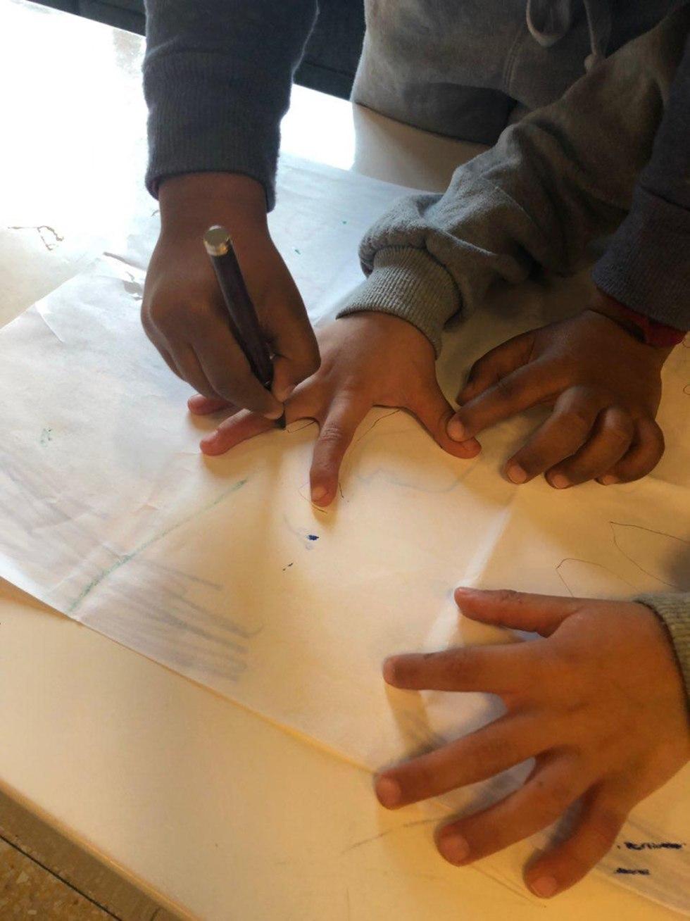 Children drawing at the shelter. (Photo: Ariella Shternbach)