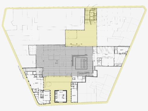 תוכנית הפרויקט. באפור מסומן שטח המוסך שהפך לספרייה, בצהוב תוספות חדשות משני הצדדים (תכנית: באדיבות בארט ורהיין)