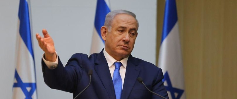 Prime Minister Benjamin Netanyahu gestures as he discusses Hezbollah's cross-border attack tunnels