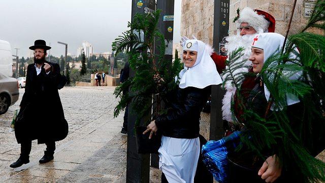 חג המולד בעיר העתיקה בירושלים (צילום: AFP)
