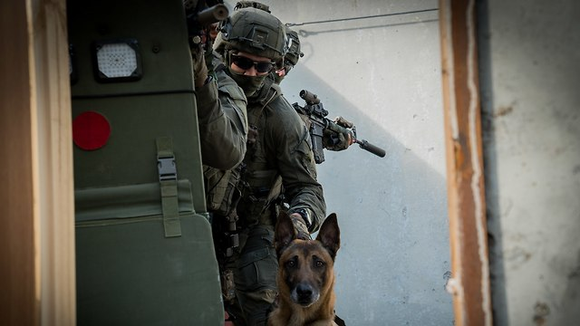 Rambo with officers of Israel Police counter-terrorism unit (Photo: Courtesy)  (Photo: Police Spokesperson's Unit)