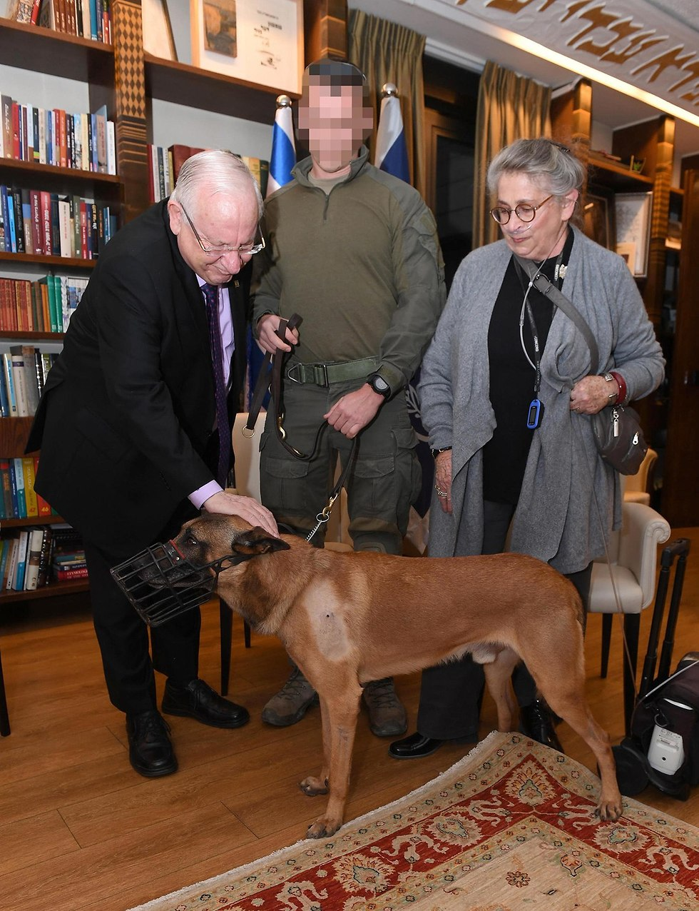 Rambo visits President Reuven Rivlin (L) and his wife at the President's Residence, December 25, 2018 (Photo: Mark Neiman, GPO)