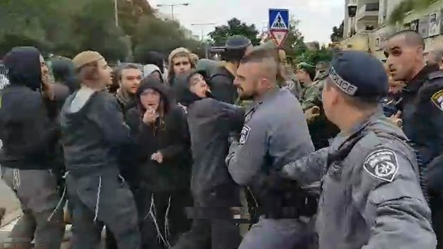Settler youth clash with police outside the courtroom holding a hearing in the case of three Jewish terrorism suspects