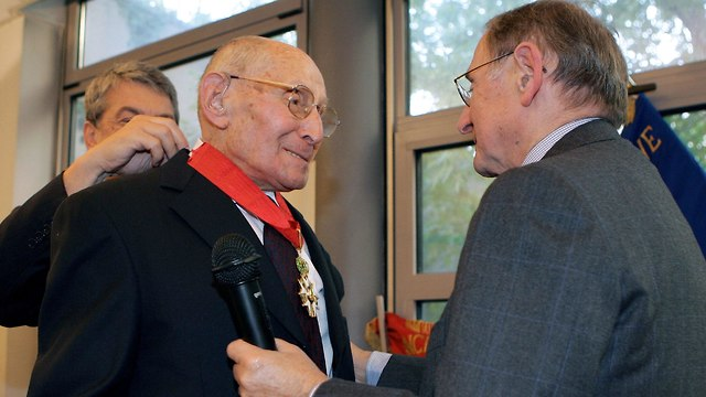 Georges Loinger receiving his French Legion of Honor medal (Photo: AFP)