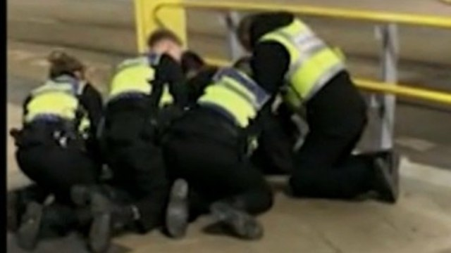 Greater Manchester Police detain a stabbing suspect at Victoria Station during NYE celebrations (Photo: BBC screenshot)
