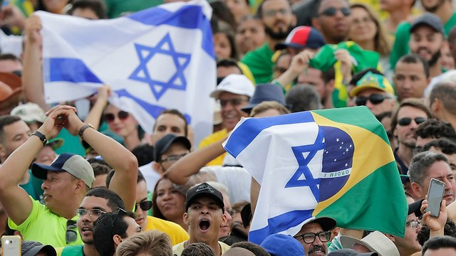 The crowd waving Israeli flags during the swearing in ceremony in Brasilia on Tuesday (Photo: AP)