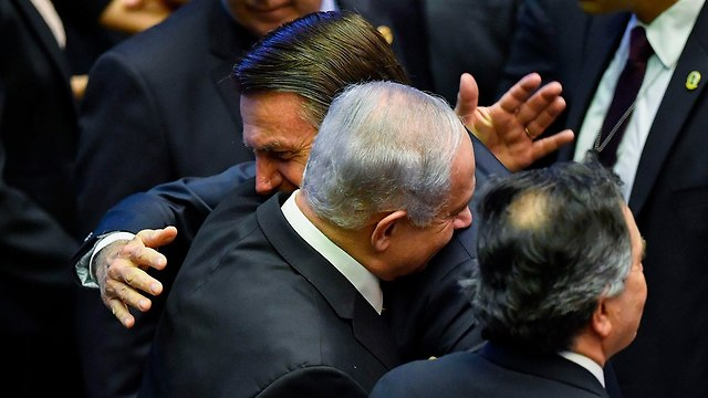 Prime Minister Benjamin Netanyahu with new Brazilian President Jair Bolsonaro at his inauguration (Photo: AFP)