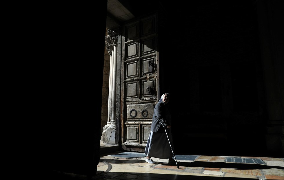 A nun enters the Church of the Holy Sepulcher