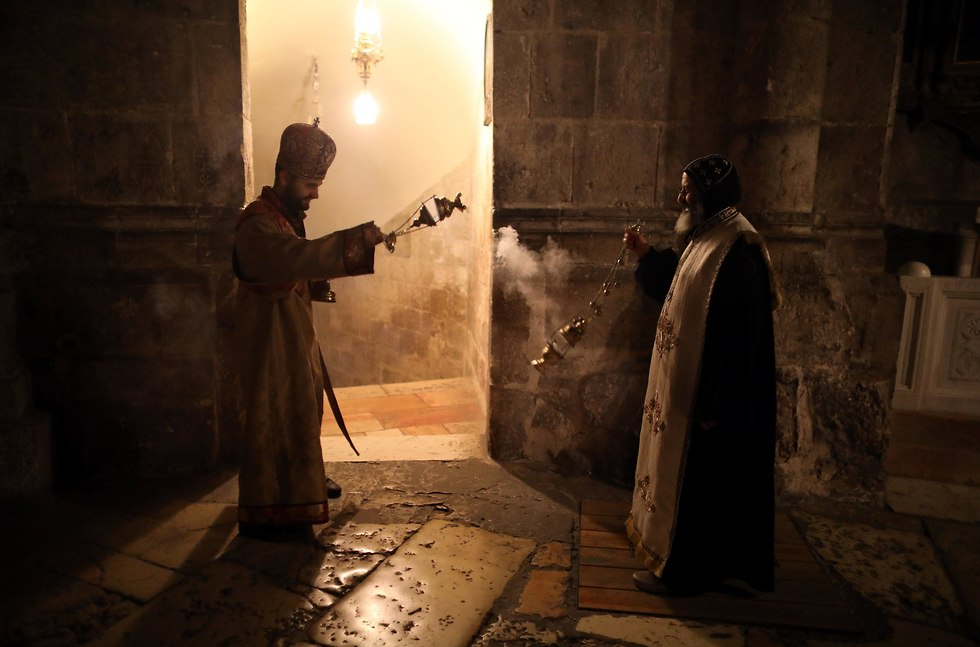 Clergy dispersing incense
