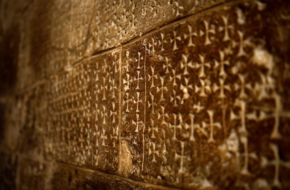 Crosses carved in the wall by pilgrims along staircase leading to crypt of St. Helena