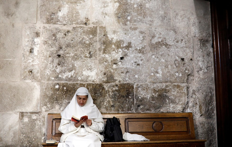 A nun in the Church of the Holy Sepulcher