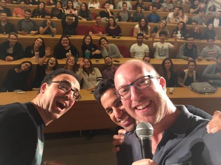 Israeli-American comedian Benji Lovitt (R) during a performance
