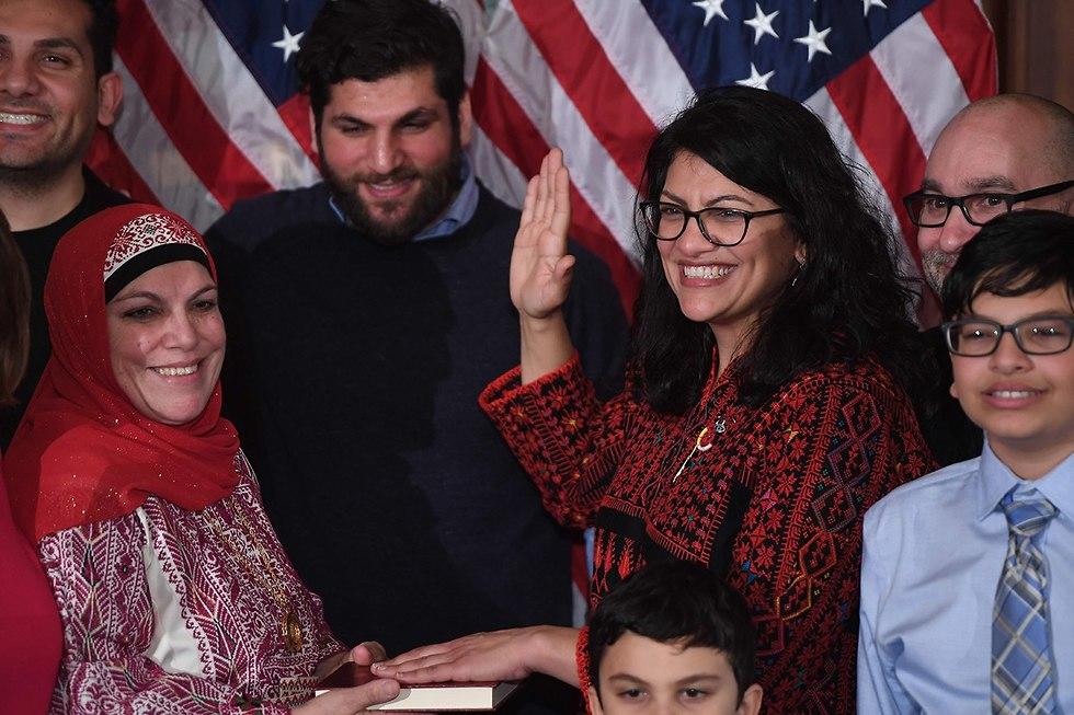 Rashida Tlaib taking the oath of office on a Quran (Photo: AFP)