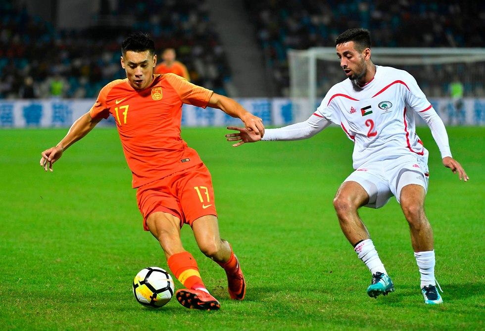 נבחרת פלסטין נגד סין בנובמבר האחרון (צילום: AFP)