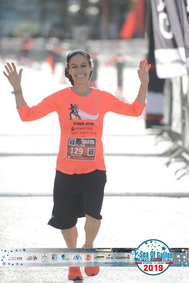 Beatie Deutsch crossing the finish line at the Tiberias Marathon, January 2019
