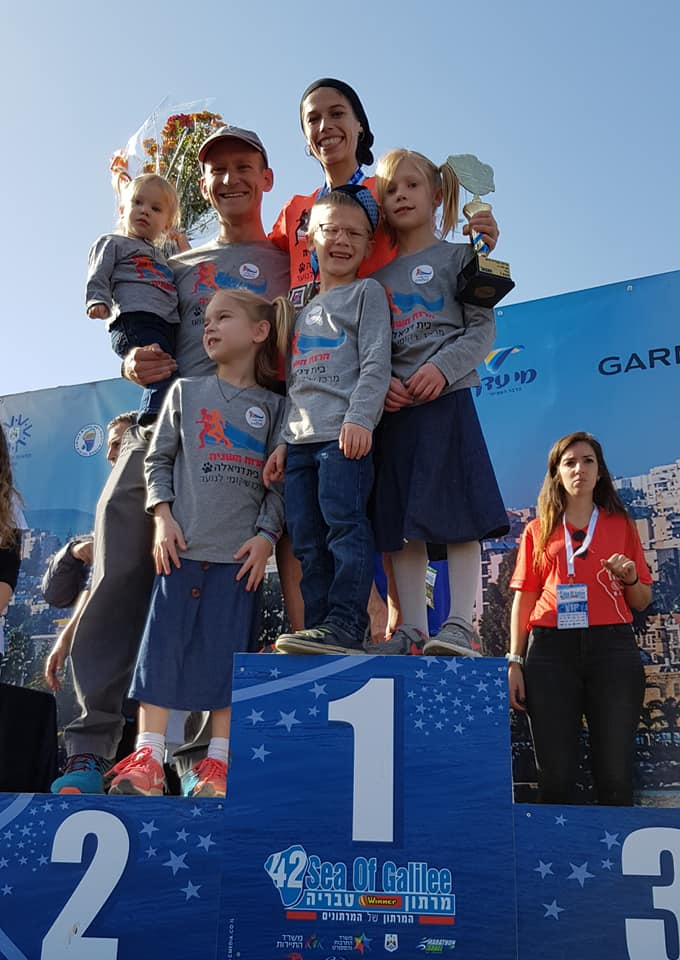 Beatie Deutsch with her children at the podium, Tiberias Marathon, January 2019