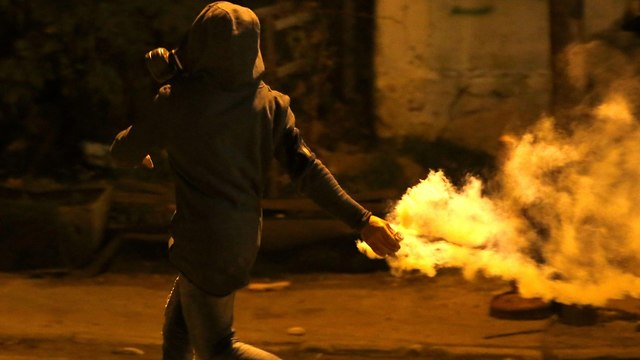Palestinians clashing with Israeli security forces in Ramallah (Photo: AFP)