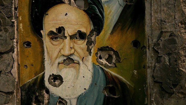 A damaged mural of Khomeini in Iran (Photo: Getty Images)