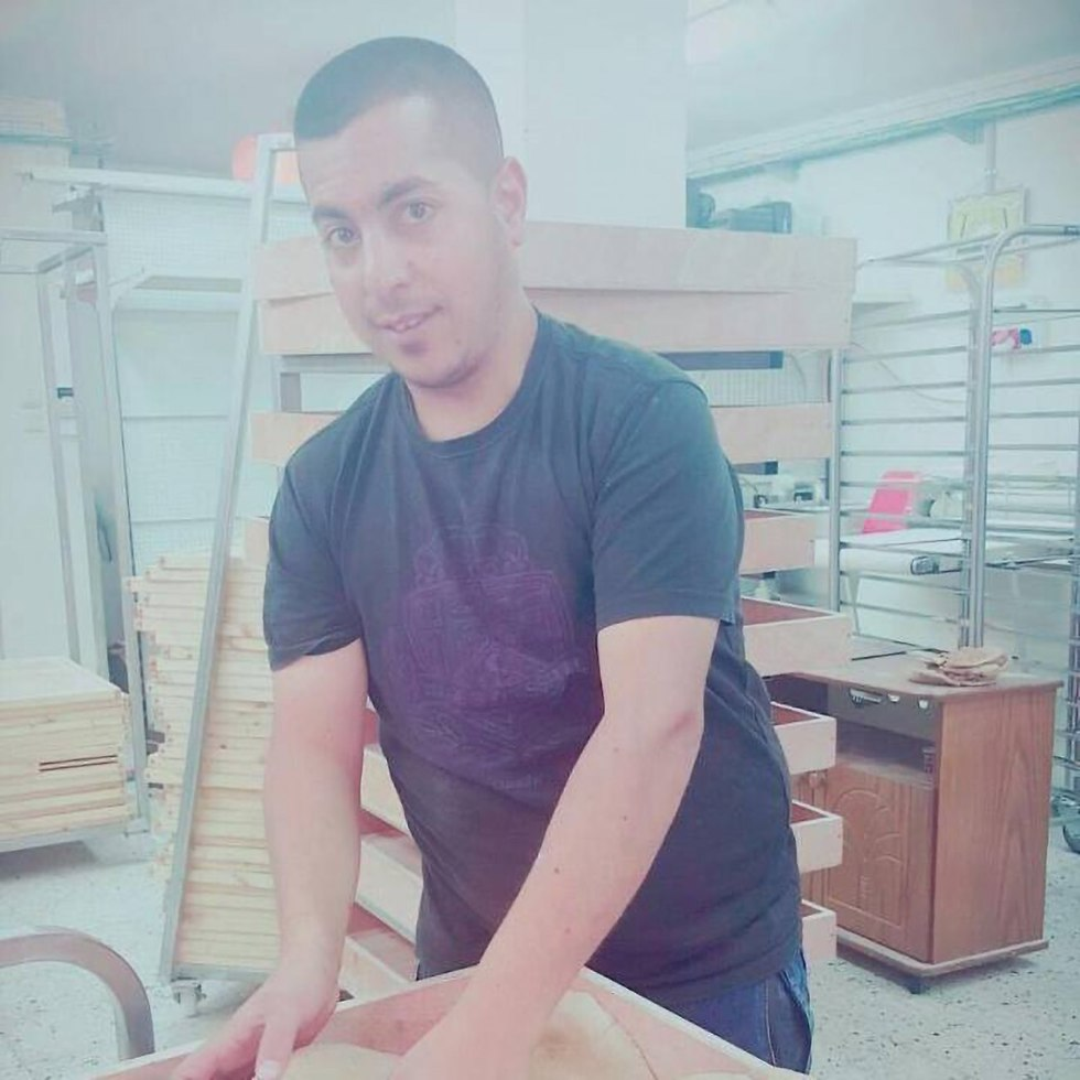 Mohammed Abu Zainab in his bakery, where Ayub was allegedly murdered (Photo: Facebook)