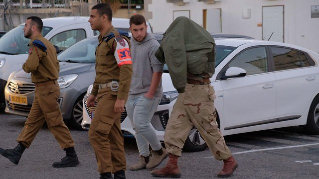 One of the soldiers' is being brought before court (Photo: Shaul Golan)