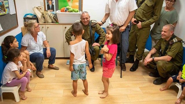 IDF Chief of Staff Lt. Gen. Gadi Eisenkot with children at an Eshkol kindergarten hit by a Gaza rocket (Photo: IDF Spokesman's Unit)