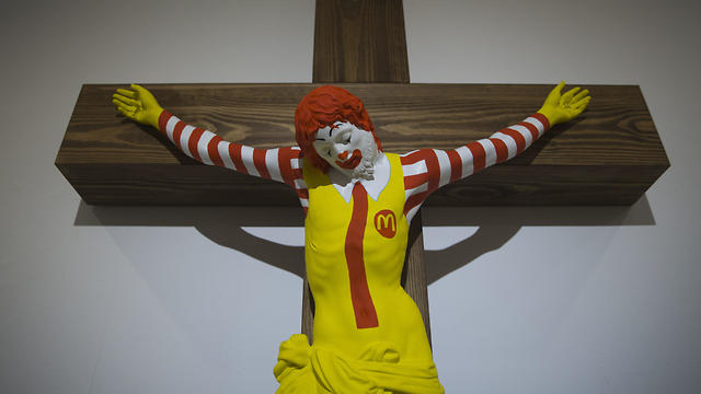Art exhibit featuring a crucified Ronald McDonald displayed at Haifa Museum