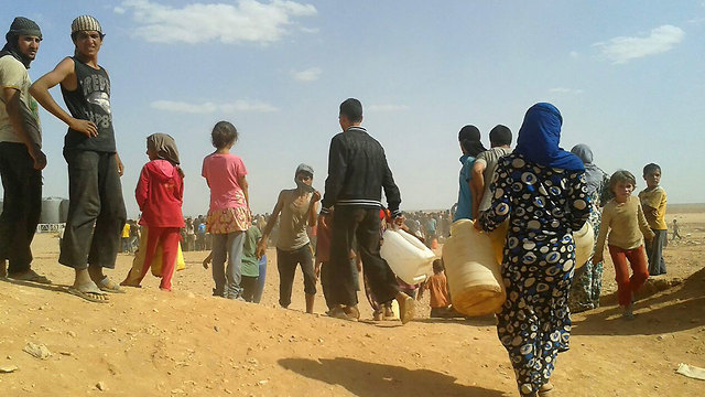 Syrians at a refugee camp  (Photo: AP)
