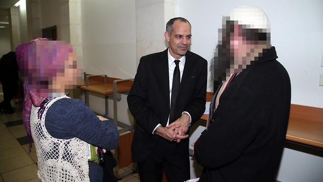 Attorney Adi Keidar with the parents of the suspect in the al-Rawbi case (Photo: Yariv Katz)