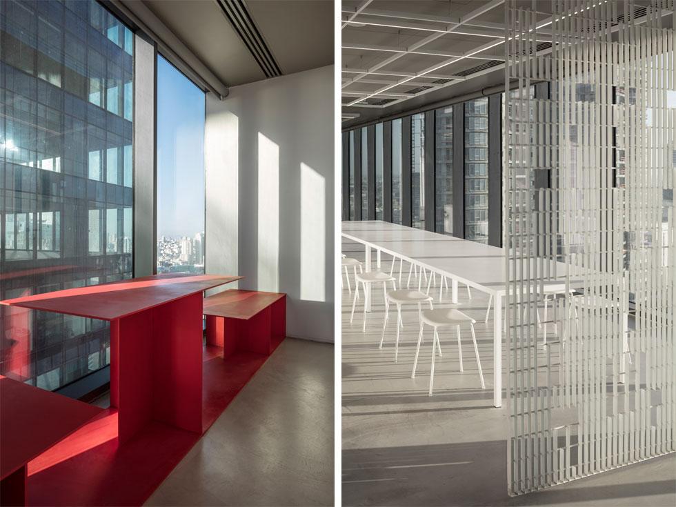 רק חריגה צבעונית אחת הרשו האדריכלים, והוא שימוש בצבע האדום (ציטוט מלוגו החברה) בשלושה רכיבים: מחיצת ההזזה של הכוכים, כיסאות אדומים בחדרי הישיבות, וספסל פלדה אדום שנמתח לכל אורך החזית הפונה לרחוב הארבעה. הספסל הדקיק משתנה בגובהו ובשימושיו (צילום: עמית גרון)