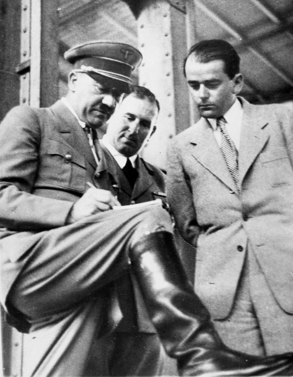 Adolf Hitler, left, discusses plans for building a convention hall at Nuremberg with Lord Mayor Willy Liebel, center, and Prof. Albert Speer, right (Photo: AP)
