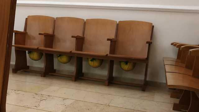 Helmets under the seats at Beth Israel synagogue