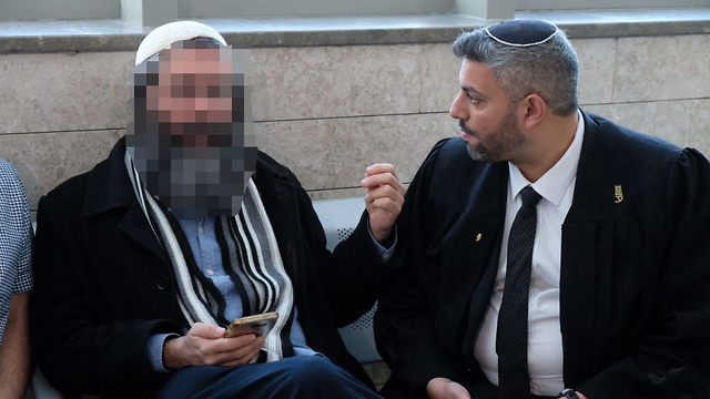 The suspect's father, left, with the suspect's lawyer Amir Bracha (Photo: Shaul Golan)