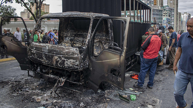 נזקי העימותים בוונצואלה (צילום: MCT)