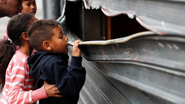 נזקי העימותים בוונצואלה (צילום: רויטרס)