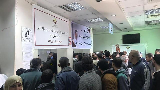 Gazans line up to receive their payout