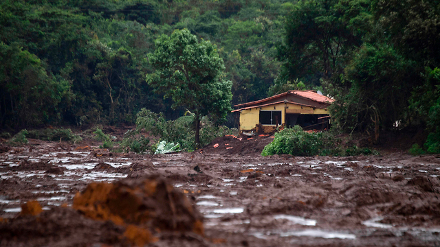 The damage caused by the dam collapse (Photo: AFP)