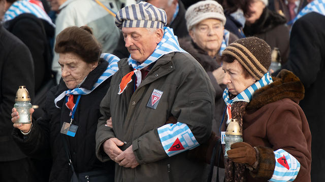 Holocaust survivors and their relatives carry candles at the Auschwitz-Birkenau death camp on International Holocaust Memorial Day, January 27, 2019 (Photo: DPA) (Photo: AP)