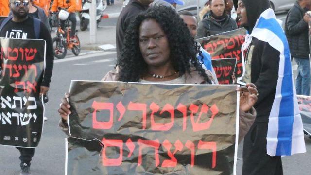 """Police are killers"" (Photo: motti Kimchi)"