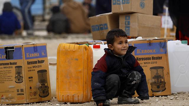 סוריה מחנה הפליטים אל חול 29 ילדים מתו (צילום: AFP)