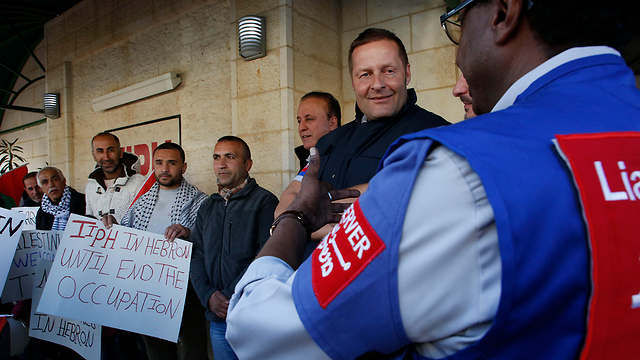 TIPH observers in Hebron (Photo: AFP)
