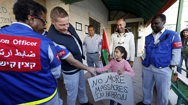 TIPH observers in Hebron (Photo: EPA)