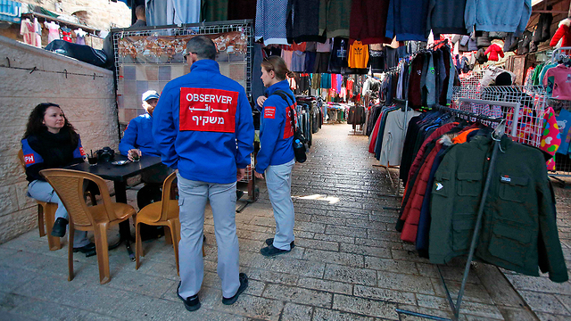 TIPH observers in Hebron (Photo; AFP)