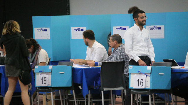 Likud voters cast their ballot in primary elections