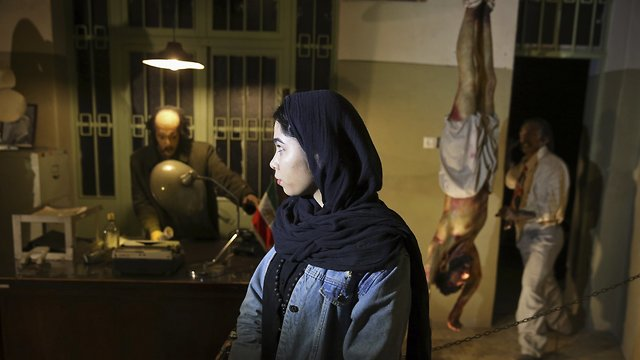 An Iranian looks at an exhibition at a former prison run by the pre-revolution intelligence service, Savak, now a museum, where wax mannequins of interrogators and a prisoner are displayed, in downtown Tehran, Iran.  (Photo: AP)