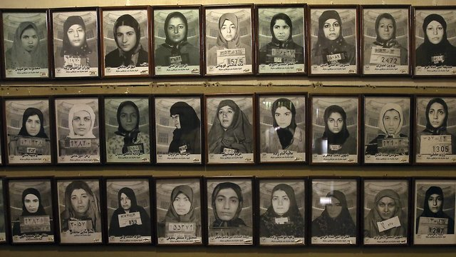 Mug shots of former prisoners hang on the wall at a former prison run by the pre-revolution intelligence service, Savak, now a museum, in downtown Tehran, Iran. (Photo: AP)