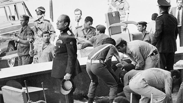 Egyptian soldiers tend to wounded after an attack on the reviewing platform which killed Egyptian President Anwar Sadat in Cairo, Egypt
